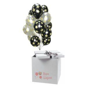 Облако черных и серебряных шаров с рисунком золотых звезд в коробке