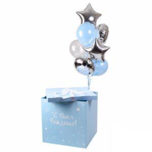 Композиция из голубых и серебряных шаров в голубой коробке