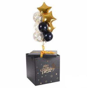 Композиция из черно-золотых шаров в черной коробке