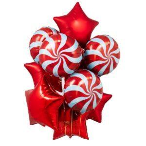 Композиция из красных звезд с конфетками