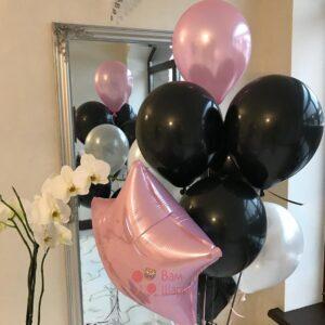 Композиция из черных шаров с розовой звездой